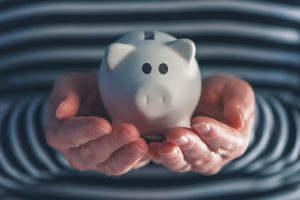 Woman's hands holding piggy bank, budget and savings concept